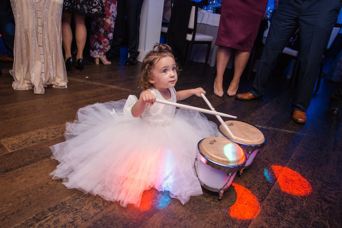 Flower girl playing the small drums