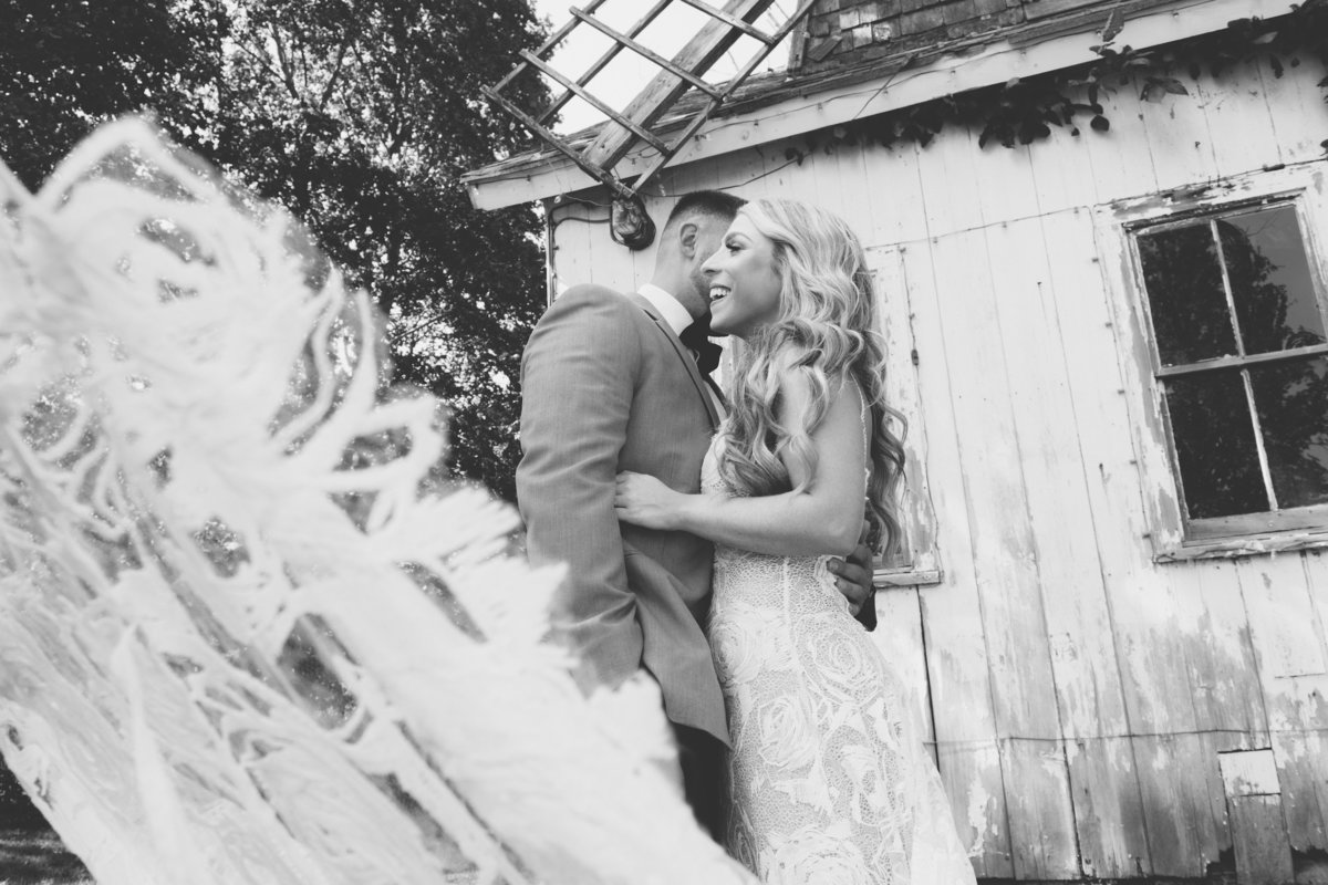 black and white photo of bride and groom outside Giorgios Baiting Hollow