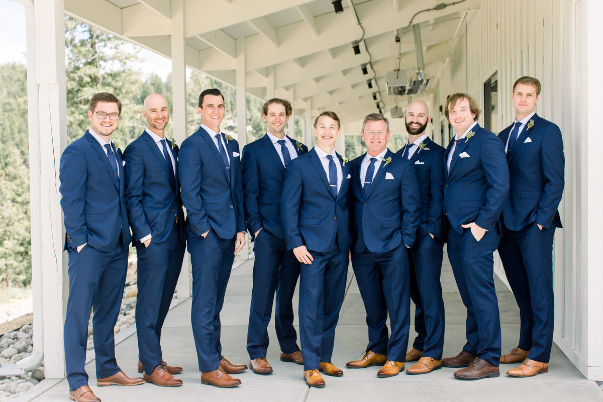 Group photo of groomsmen in blue suits