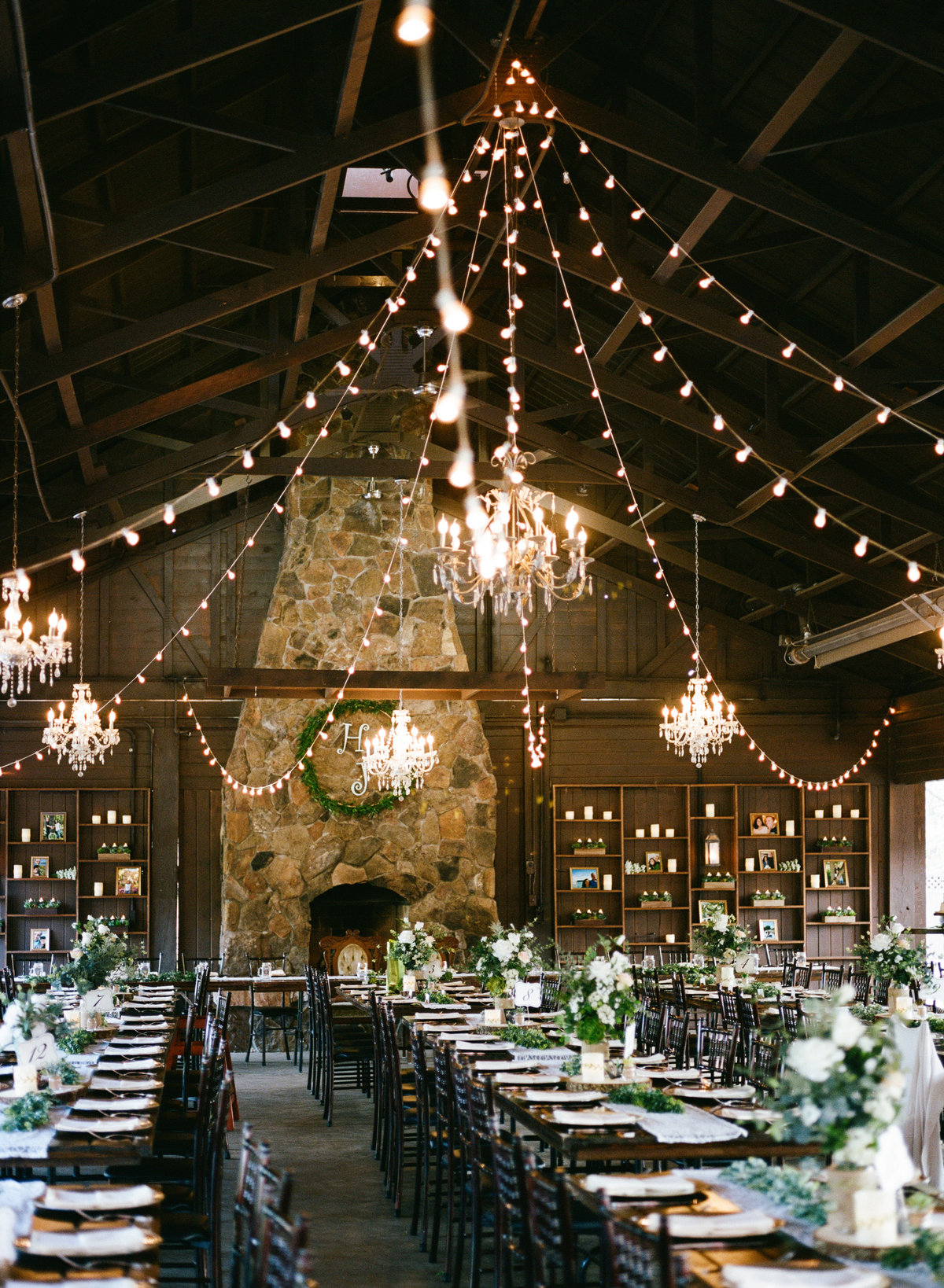 cottage grove wedding venue of dark woods and cafe lights wedding reception woodland feel
