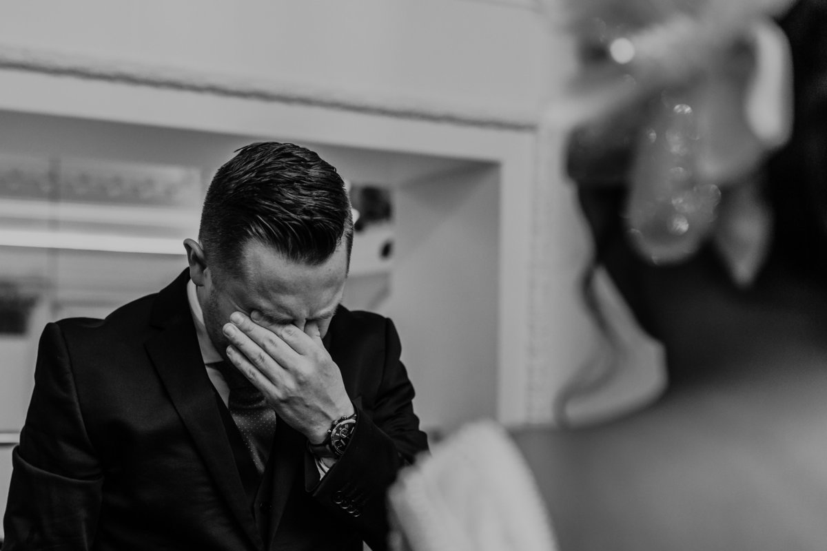 A groom cries during a surprise first look before teh ceremony