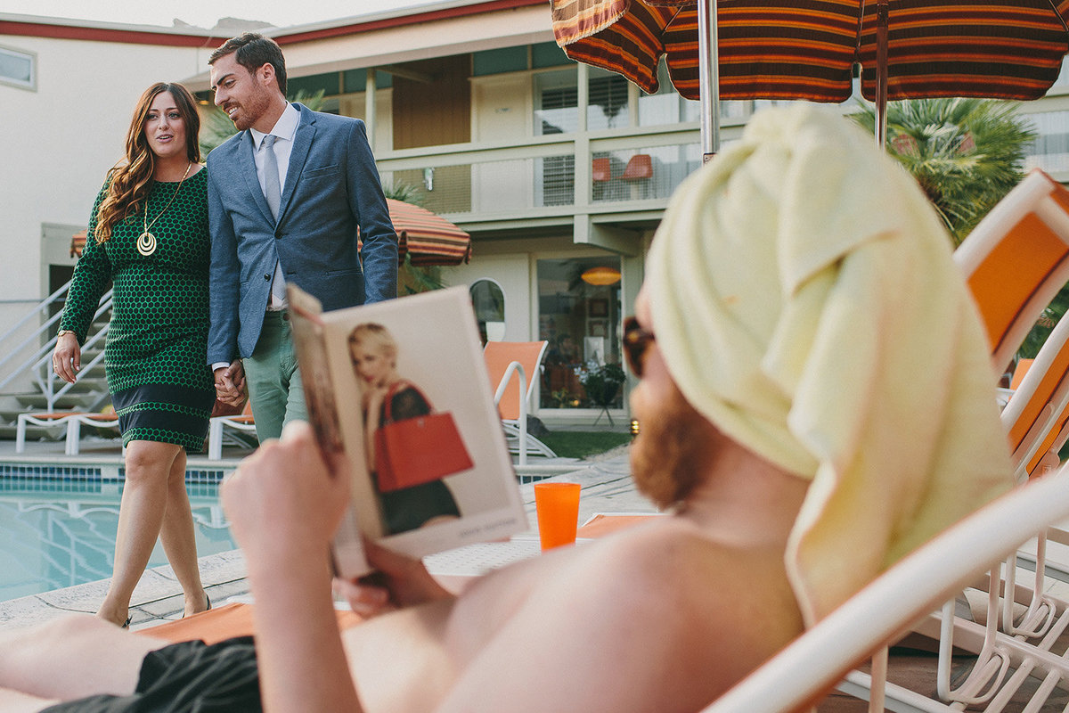 Couple walks through a mid century modern hotel for their Palmn Springs engagement session.