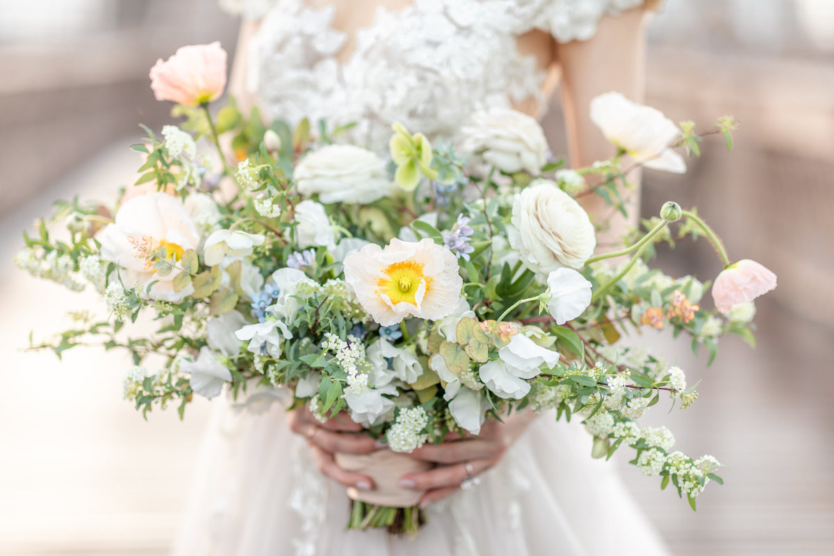 White and greenery bridal bouquet overflowing with flowers