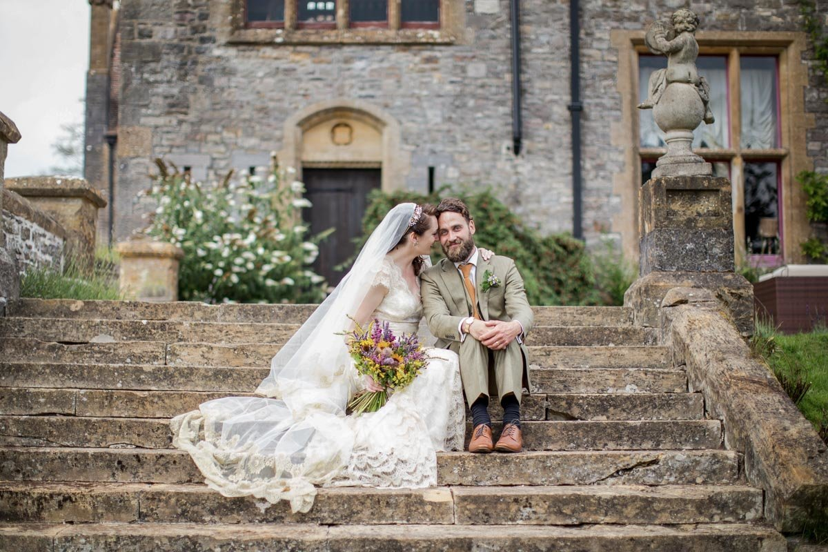 Bride and Groom on steps at Huntsham Court Devon