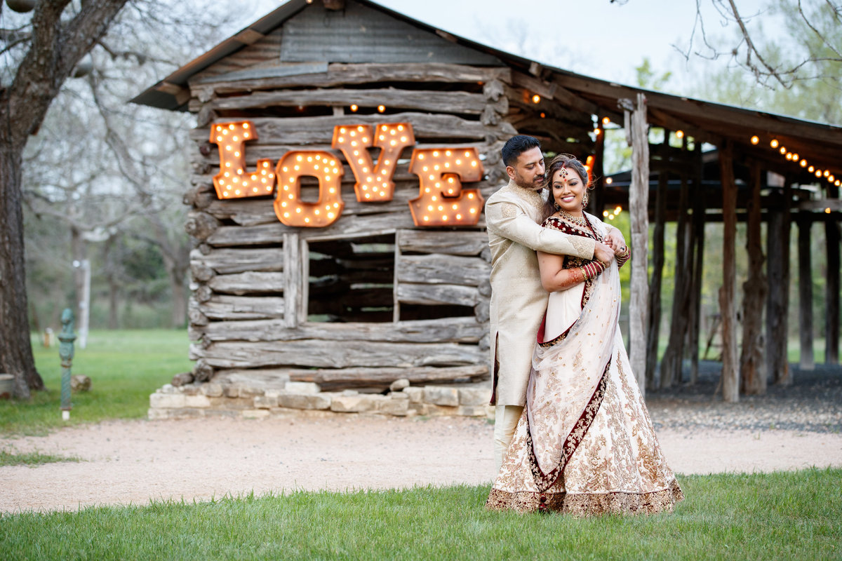 Indian wedding photographer pecan springs ranch bride groom hug love 10601 B Derecho Drive, Austin, TX 78737