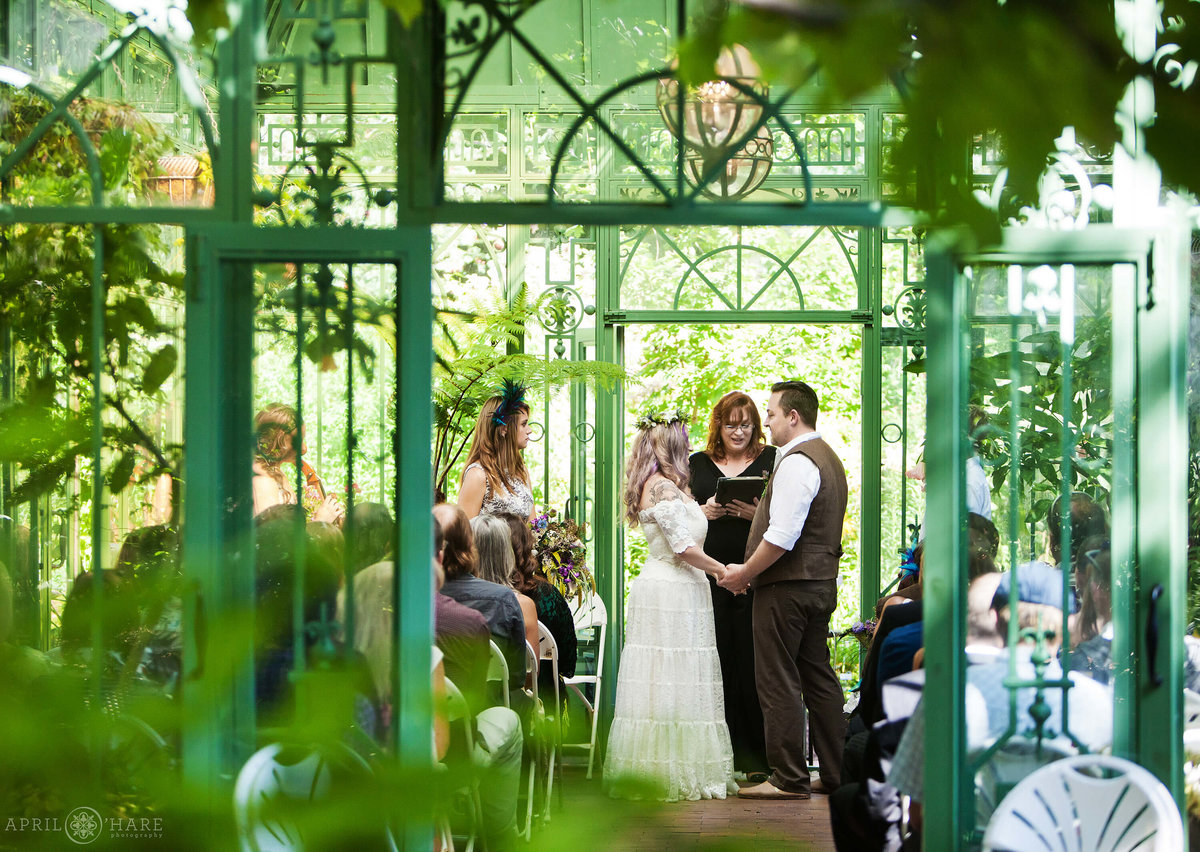 Gorgeous wedding in the green solarium at Woodland Mosaic Gardens Denver Botanic Gardens Colorado