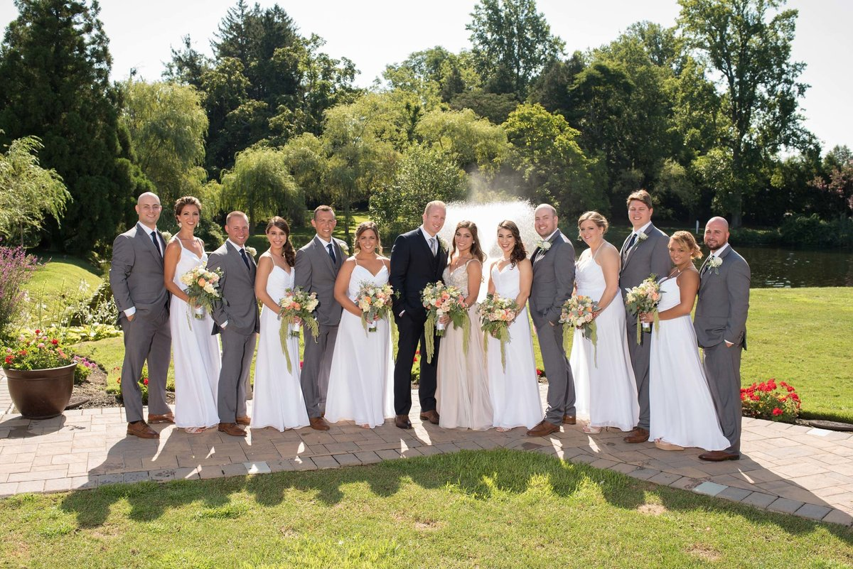 Bridal party posing outside at Flowerfield