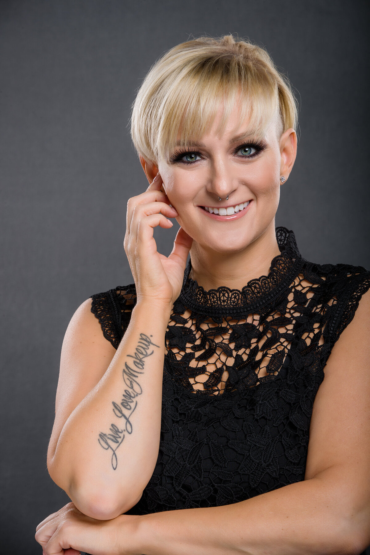 Makeup Artist headshot with tattoos showing
