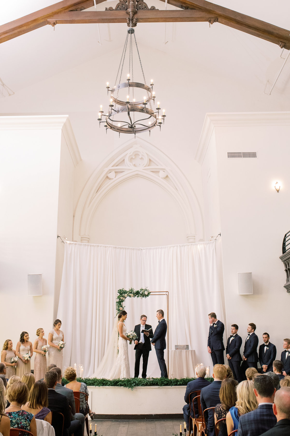 Wide shot of a wedding ceremony taking place at the Transept OTR in Cincinnati, OH