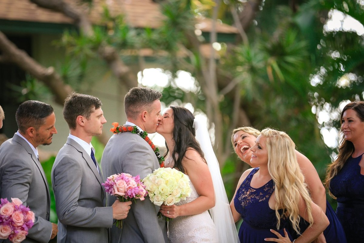 Capture Aloha Photography at The Westin Maui Resort and Spa with Newly Wedding Kissing with Bridesmaid and Groomsmen