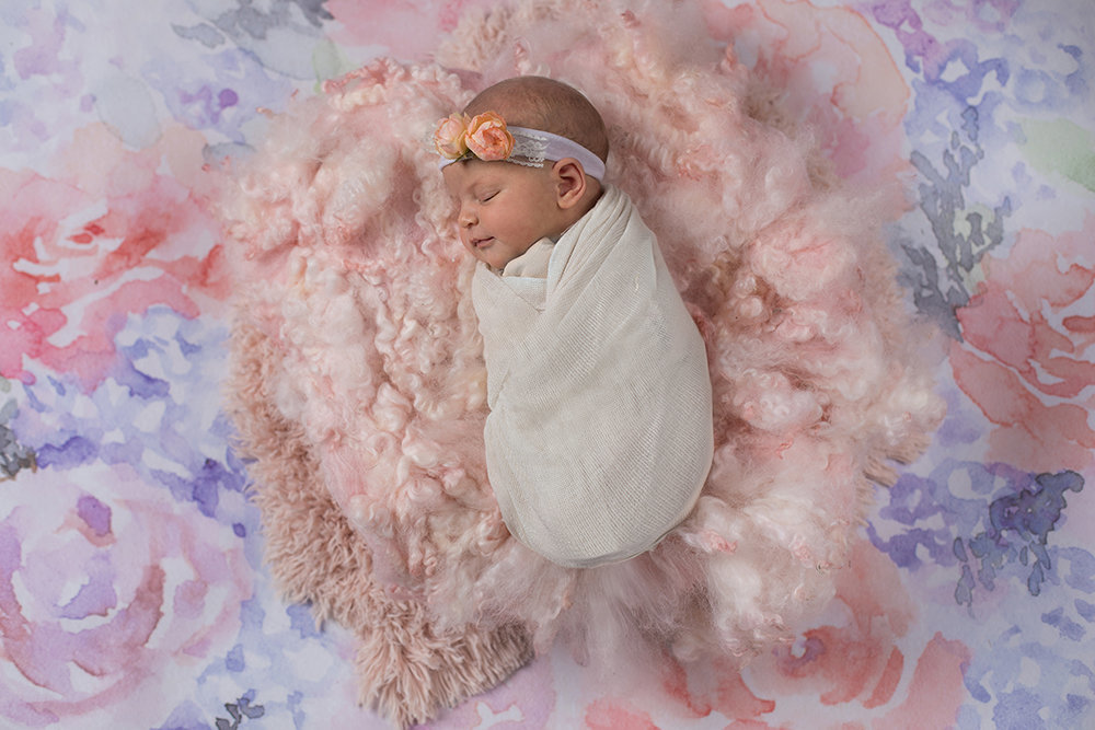 newborn baby girl in florals