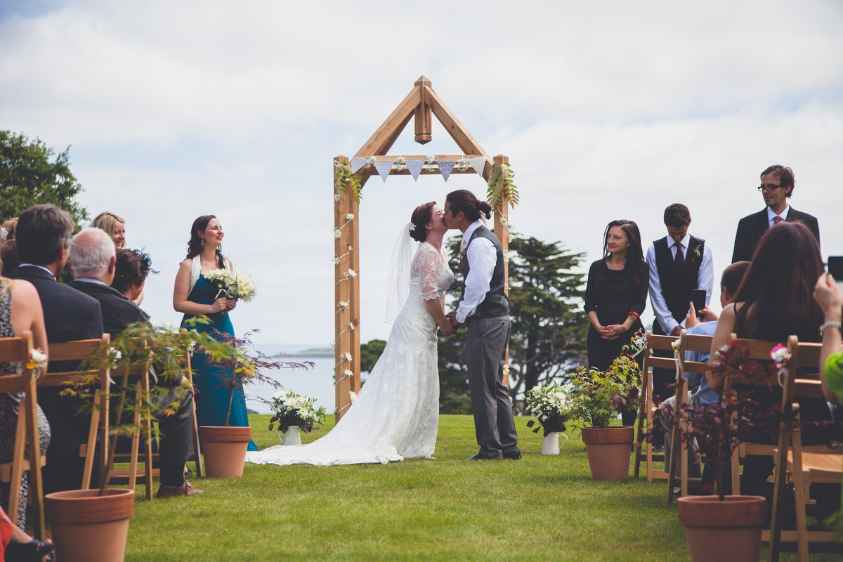 Bride and groom kiss ceremony
