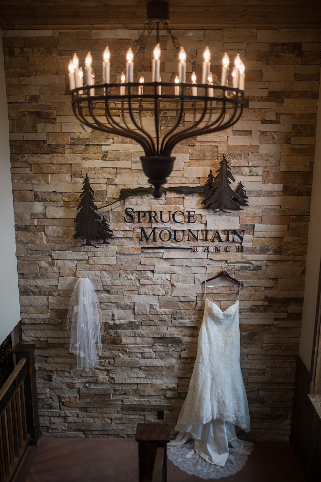 wedding dress hanging at ponderosa Spruce Mountain Ranch