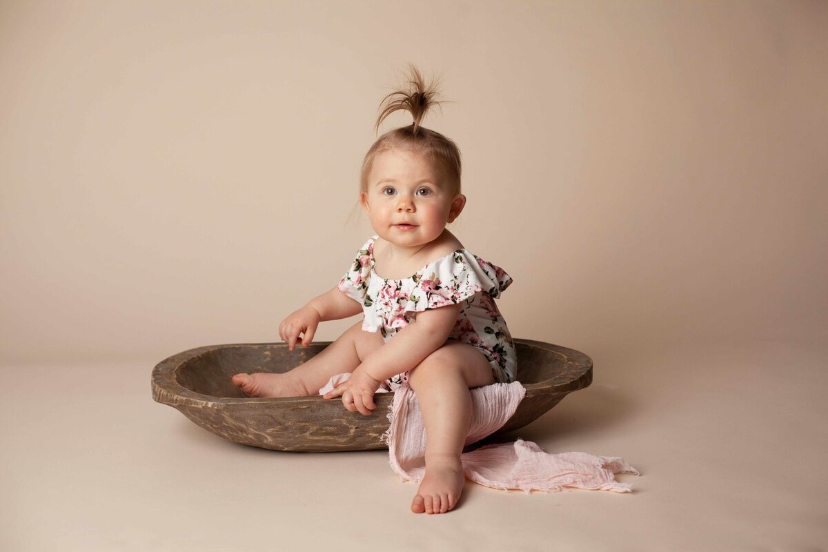 milestone baby 1 year old session flower outfit with wooden trench