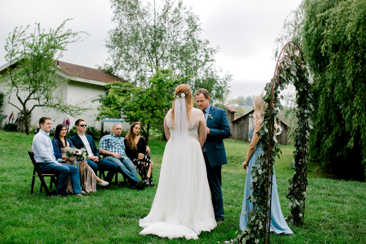 Bride and groom with guests during at Olympias Valley Estate in Petaluma California
