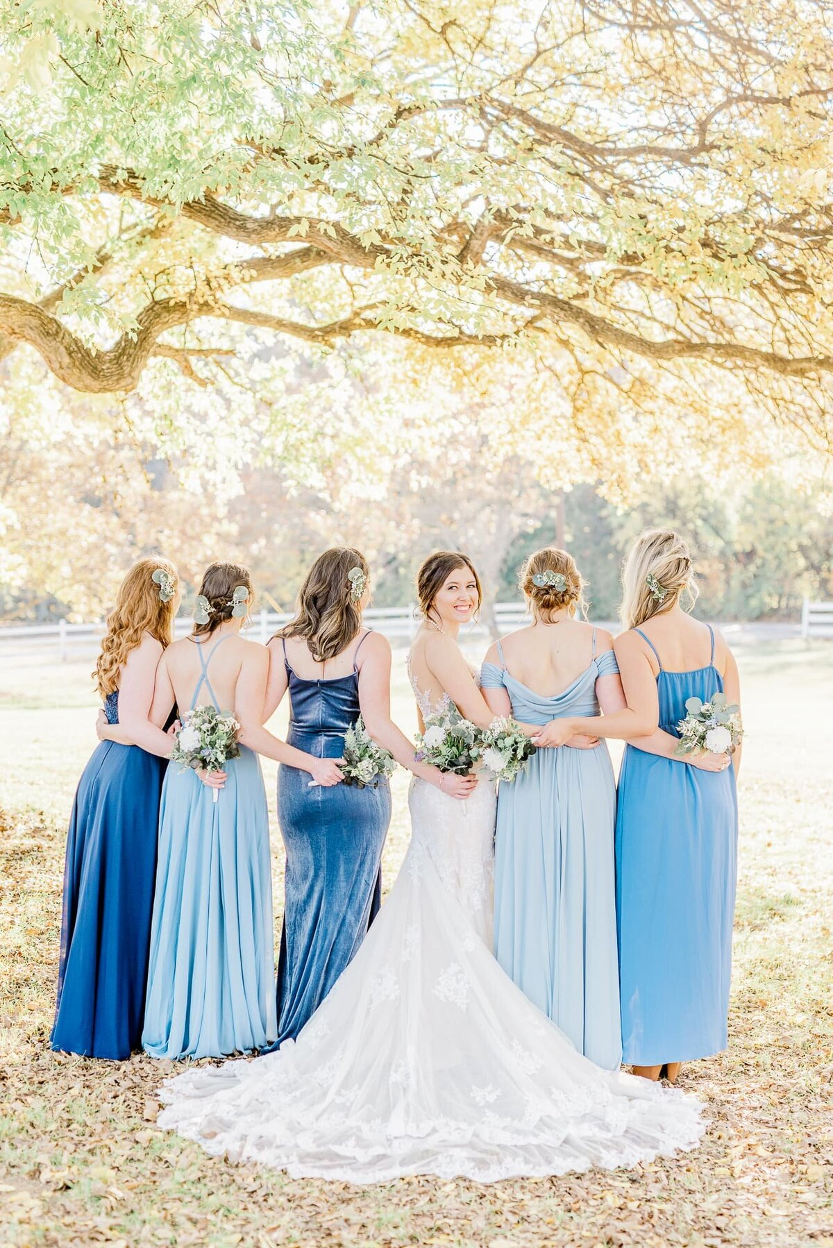 Photograph of bride with bridesmaids