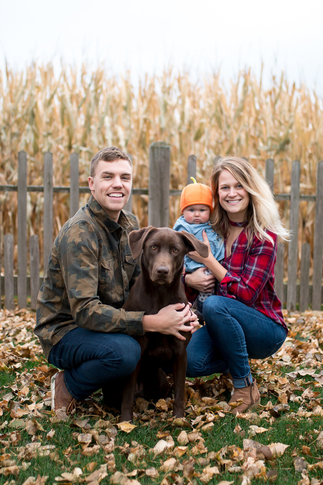 Fall family photography session with young infant and chocolate lab