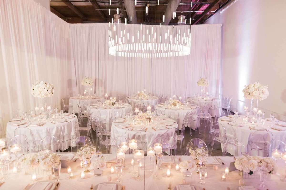 Stunning white wedding filled with candles and white floral designed by Flora Nova Design Seattle