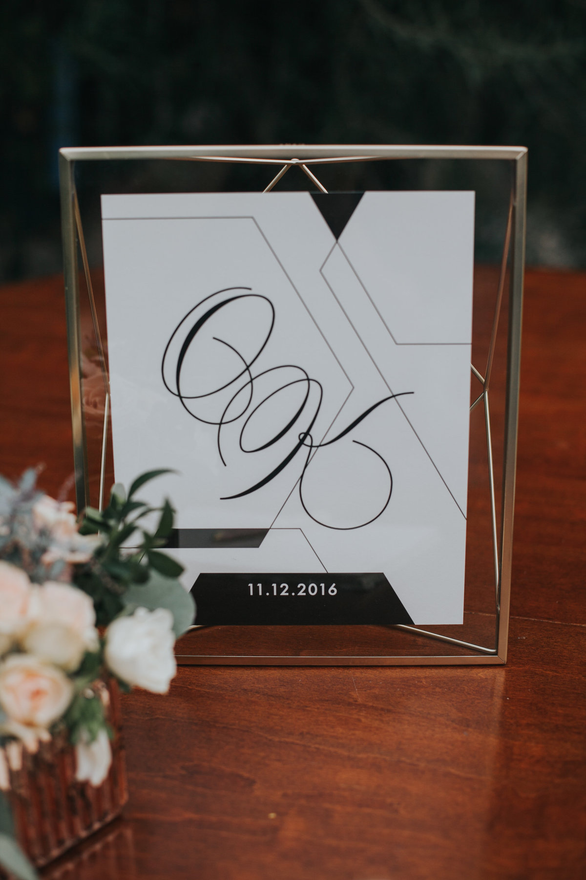 Wedding welcome table with gold glass geometric welcome sign at The Fig House