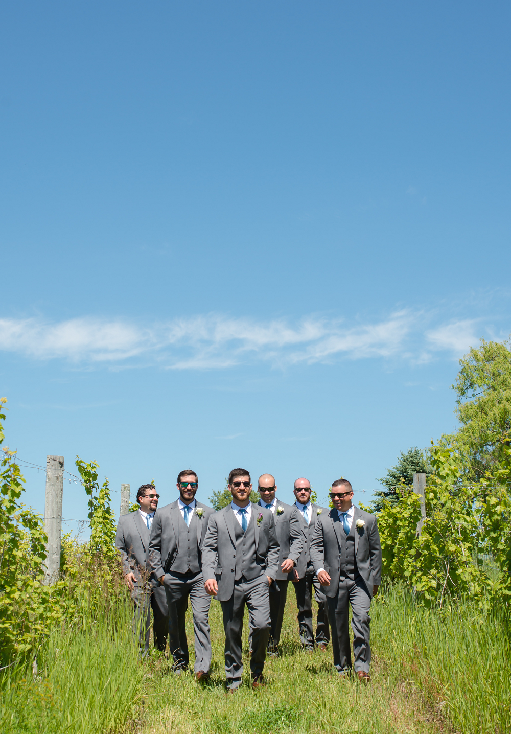 DESTINATION WEDDING IN TRAVERSE CITY WITH KRISTEN AND SCOTT Groomsmen Walking