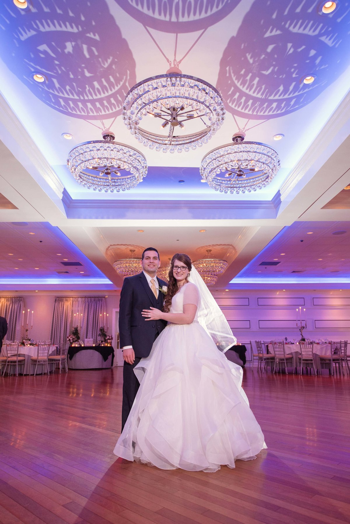 Bride and groom at the ballroom at Watermill Caterers