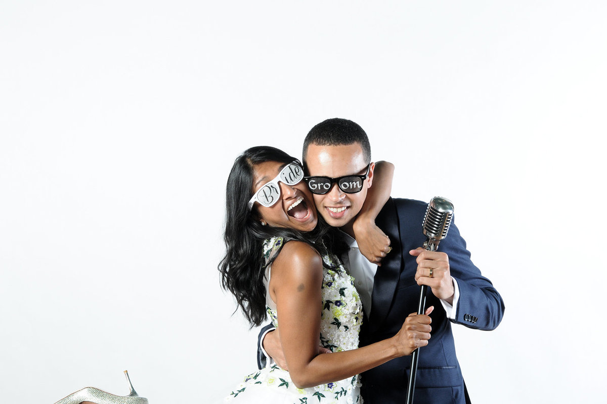 0011-Photo-Booth-Rental-at-Wedding-Reception-Guests-Having-Fun