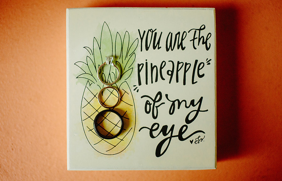 river palm cottages wedding, pineapple signs with rings