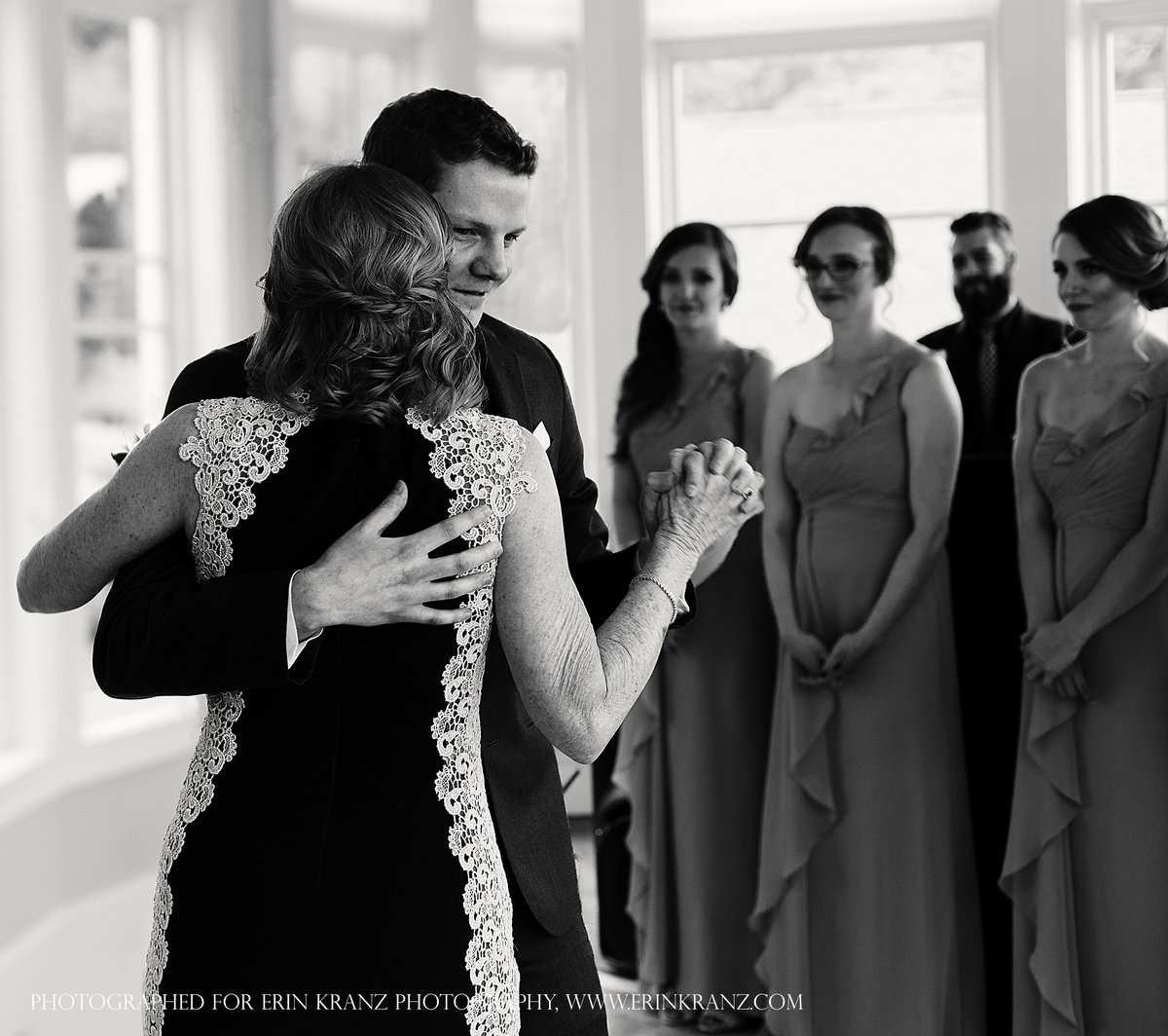charlotte wedding photographer jamie lucido captures the mother son dance while bridesmaids look on