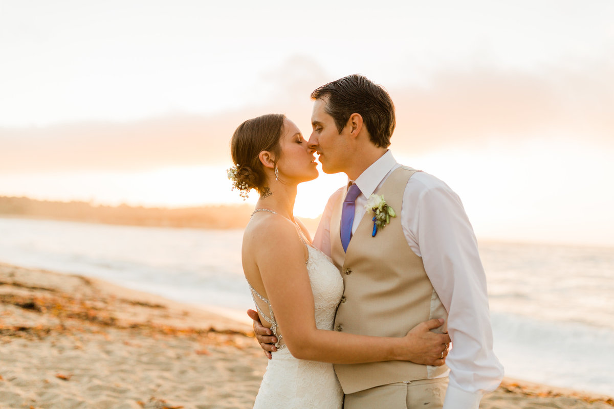 bride and groom about to kiss on the shores of carmel beach at sunset