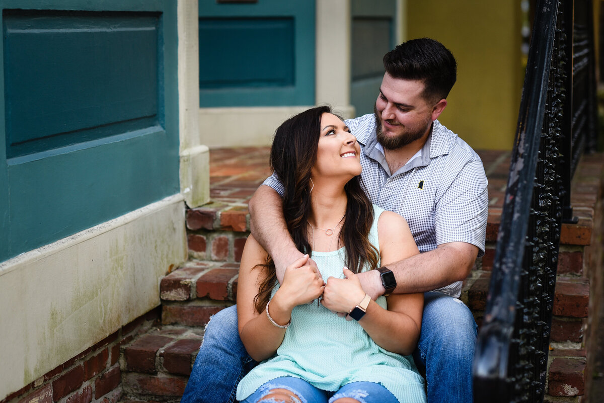 Beautiful Mississippi Engagement Photography: couple relaxes on brick staircase in Ocean Springs, MS