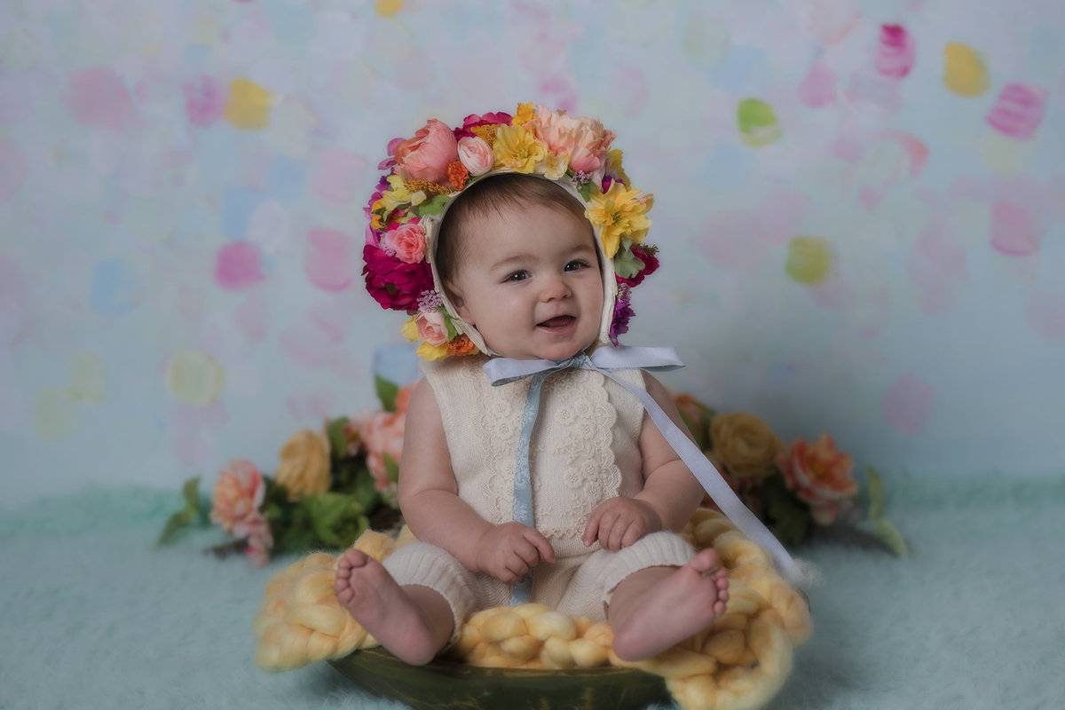 Cute baby photos in floral bonnets