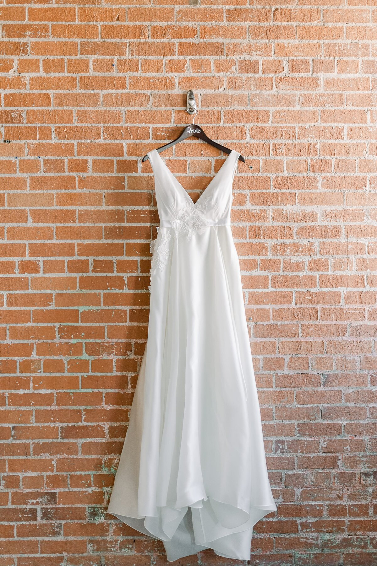 Bride-gown-on-brick-wall