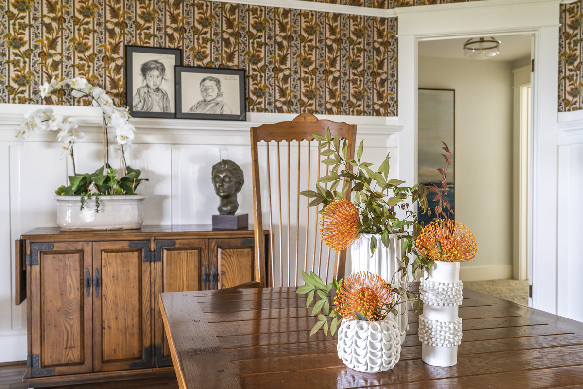 Dining room in Ojai house with wainscot and wallpaper walls