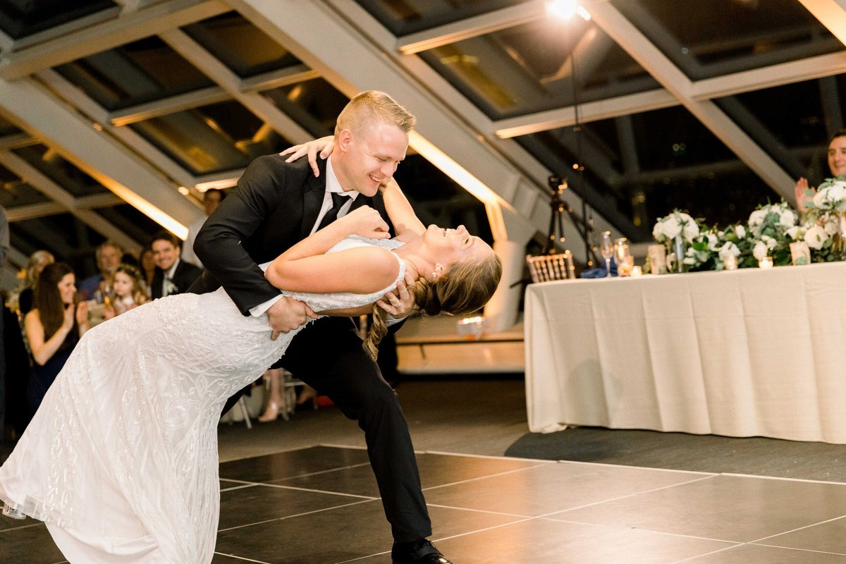 bride and groom having first dance at adler planetarium