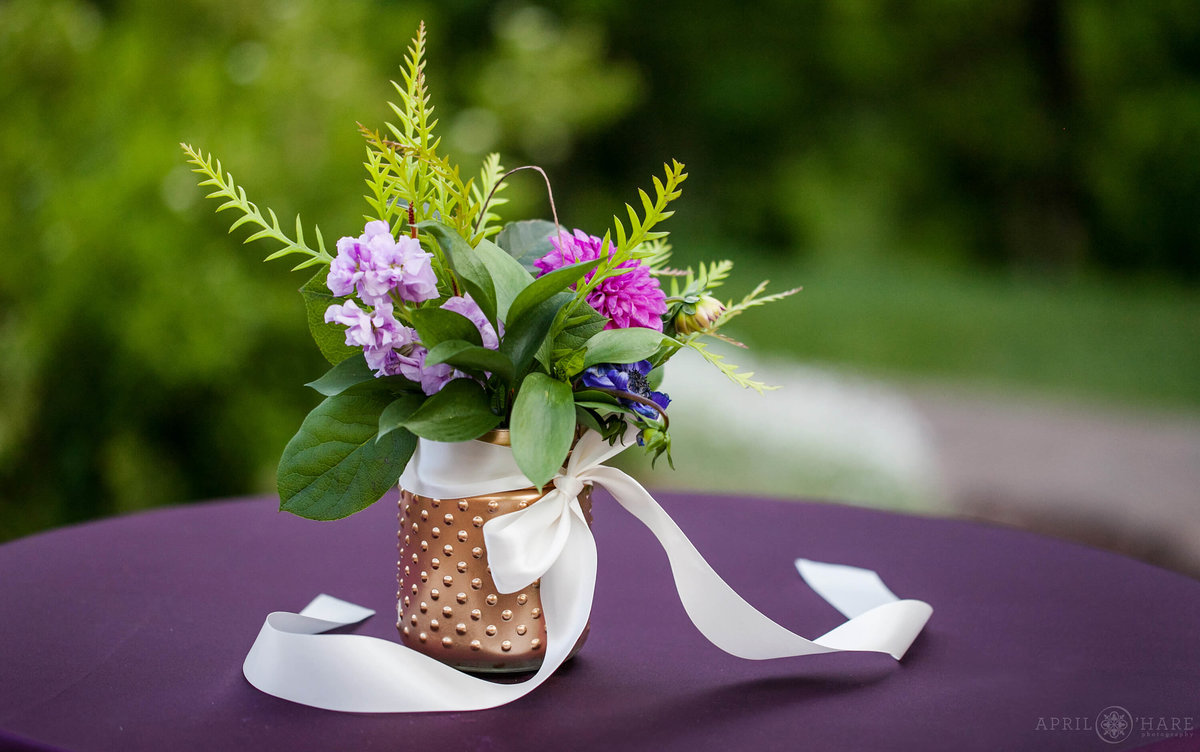 Boulder Wedding photographer cocktail table with purple linens and florals for a summer wedding at Wedgewood Weddings on Boulder Creek