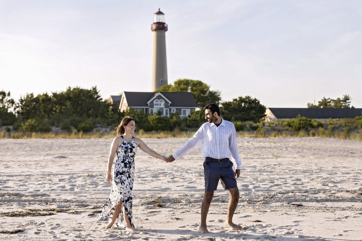 engaged couple walking lighthouse cape may nj