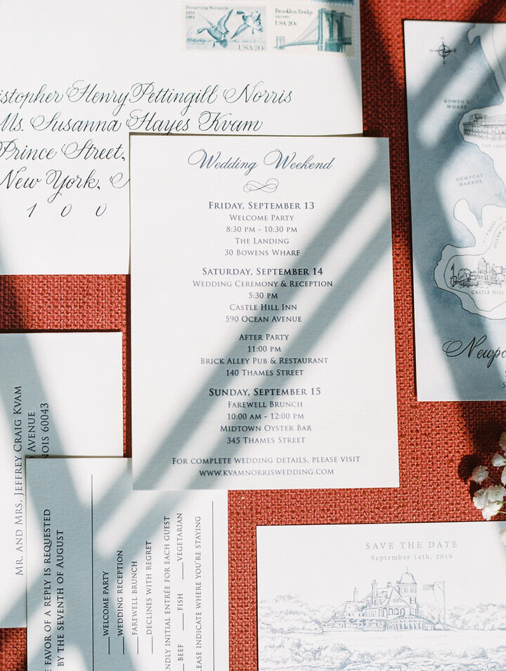 invitation suite on red background for castle hill inn wedding
