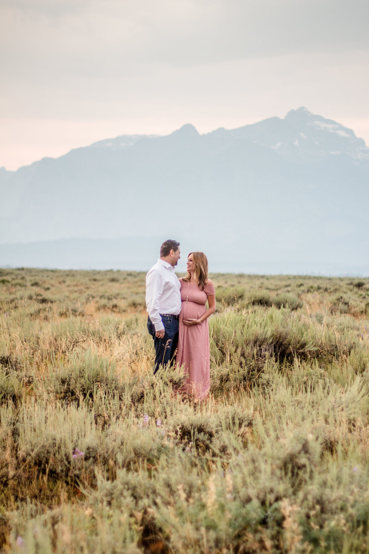 Maternity session, family, husband and wife, sage grass field, Jackson Hole, Airport, Tetons
