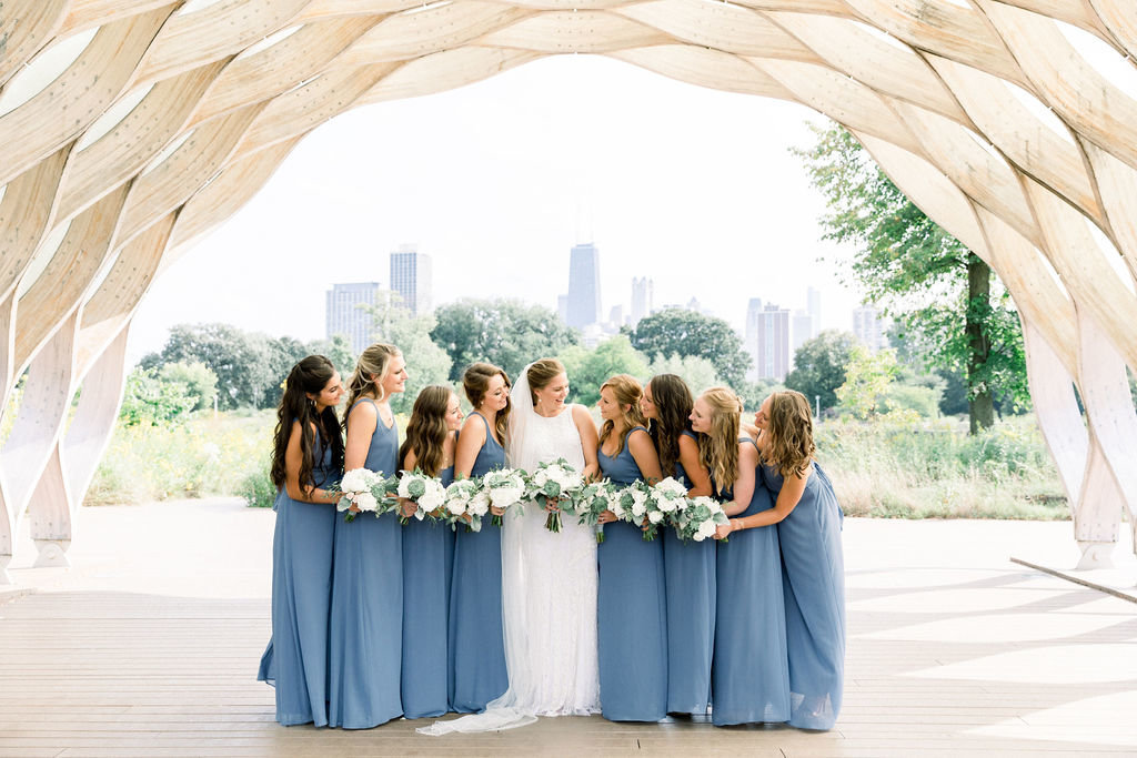 Bridal party bridesmaids with bride under honeycomb structure