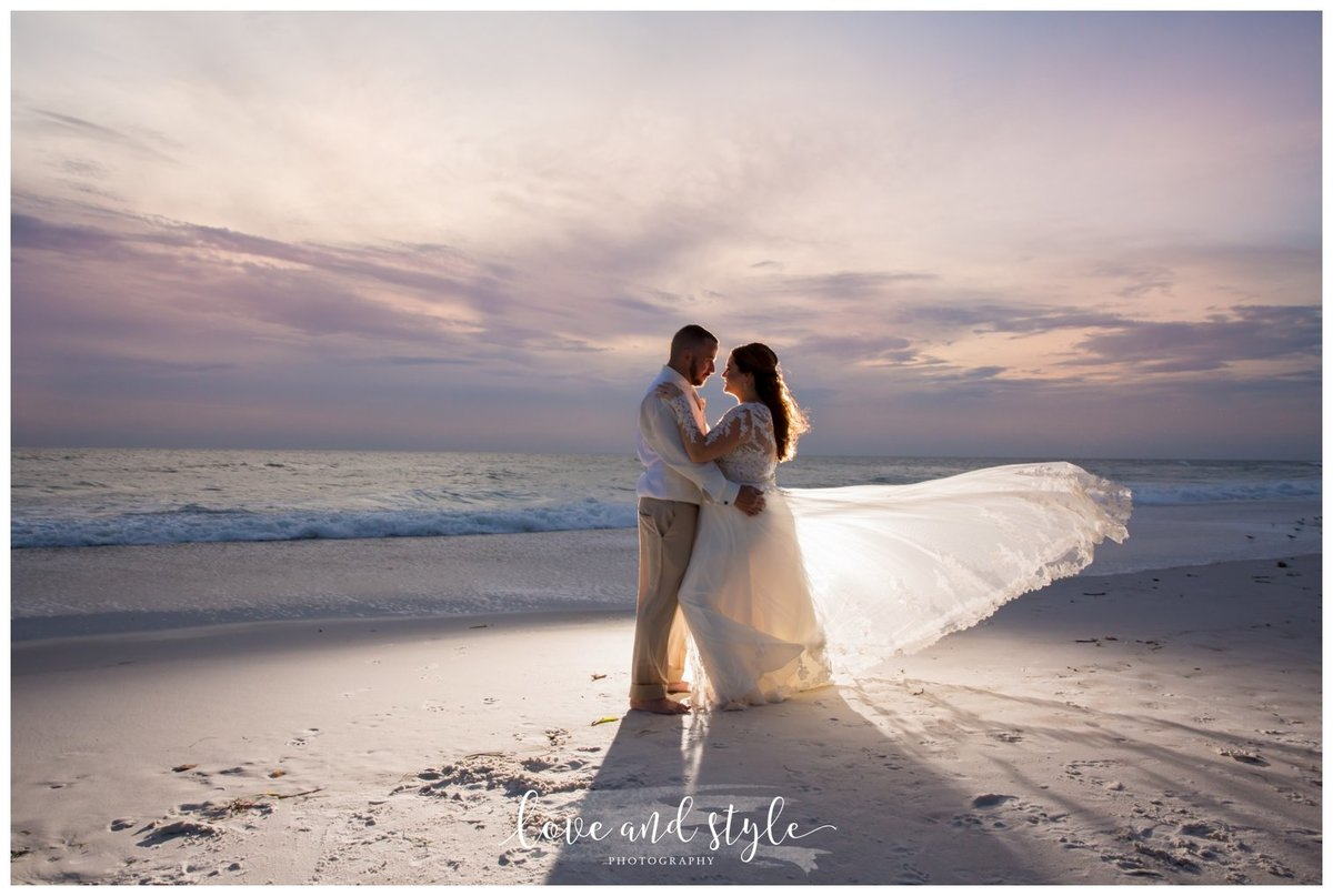 Sarasota-Bradenton Wedding Photography of bride and groom walking on the beach at sunset