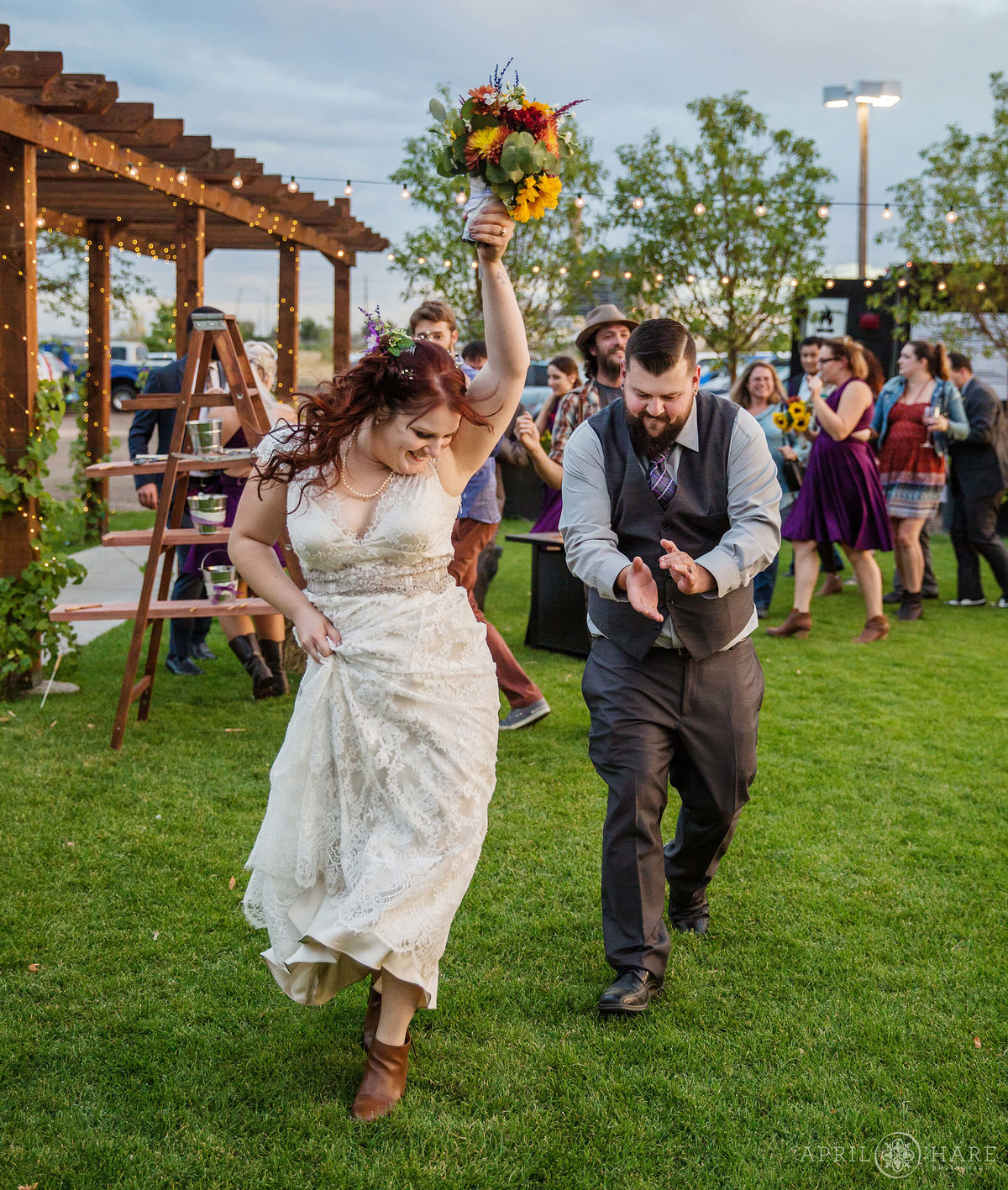 Celebrating at an outdoor Colorado wedding reception at Balistreri Vineyard
