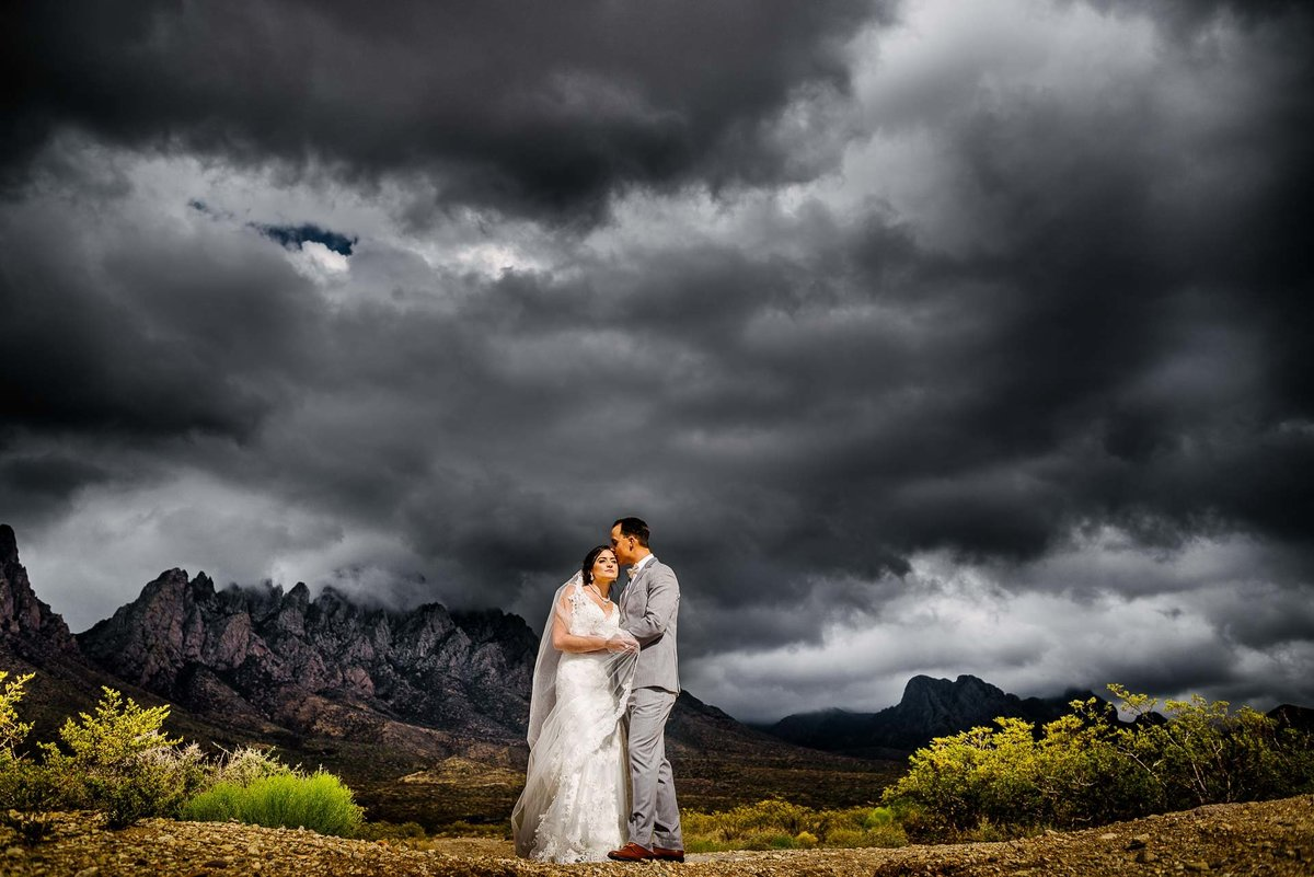 bride and groom portrait in front of organ mountains in las cruces new mexico by stephane lemaire photography