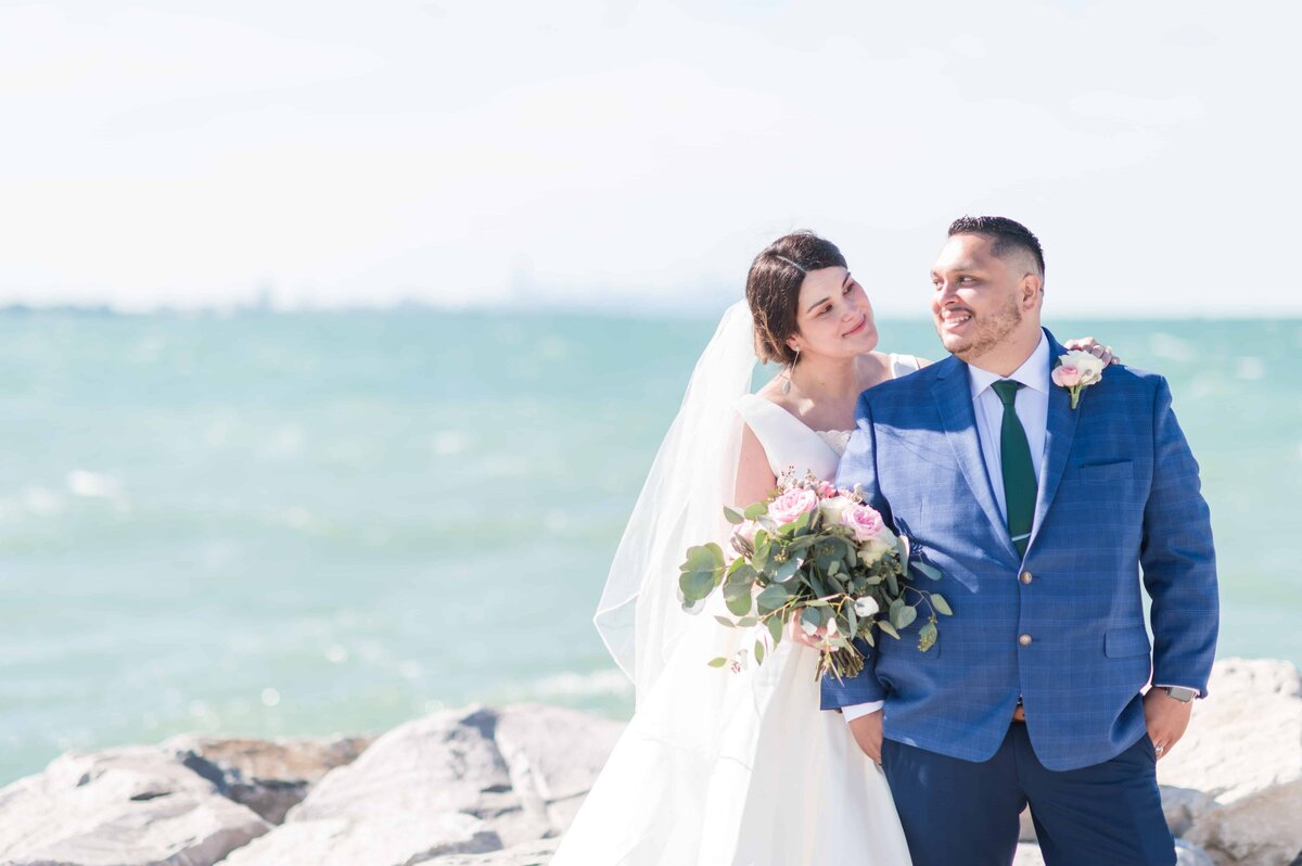 Bride and groom posing near Lake Michigan