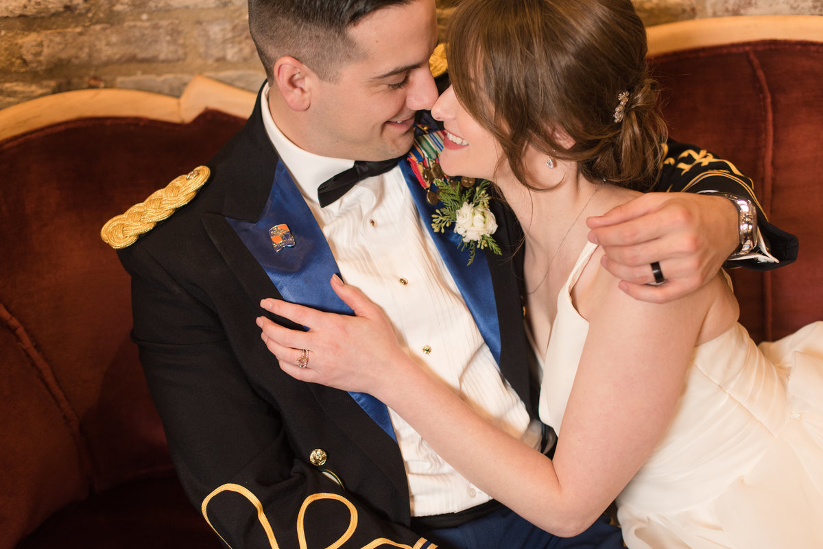 army officer groom and bride hold each other during wedding at 718 venue fredericksburg by hampton roads virginia wedding photographer