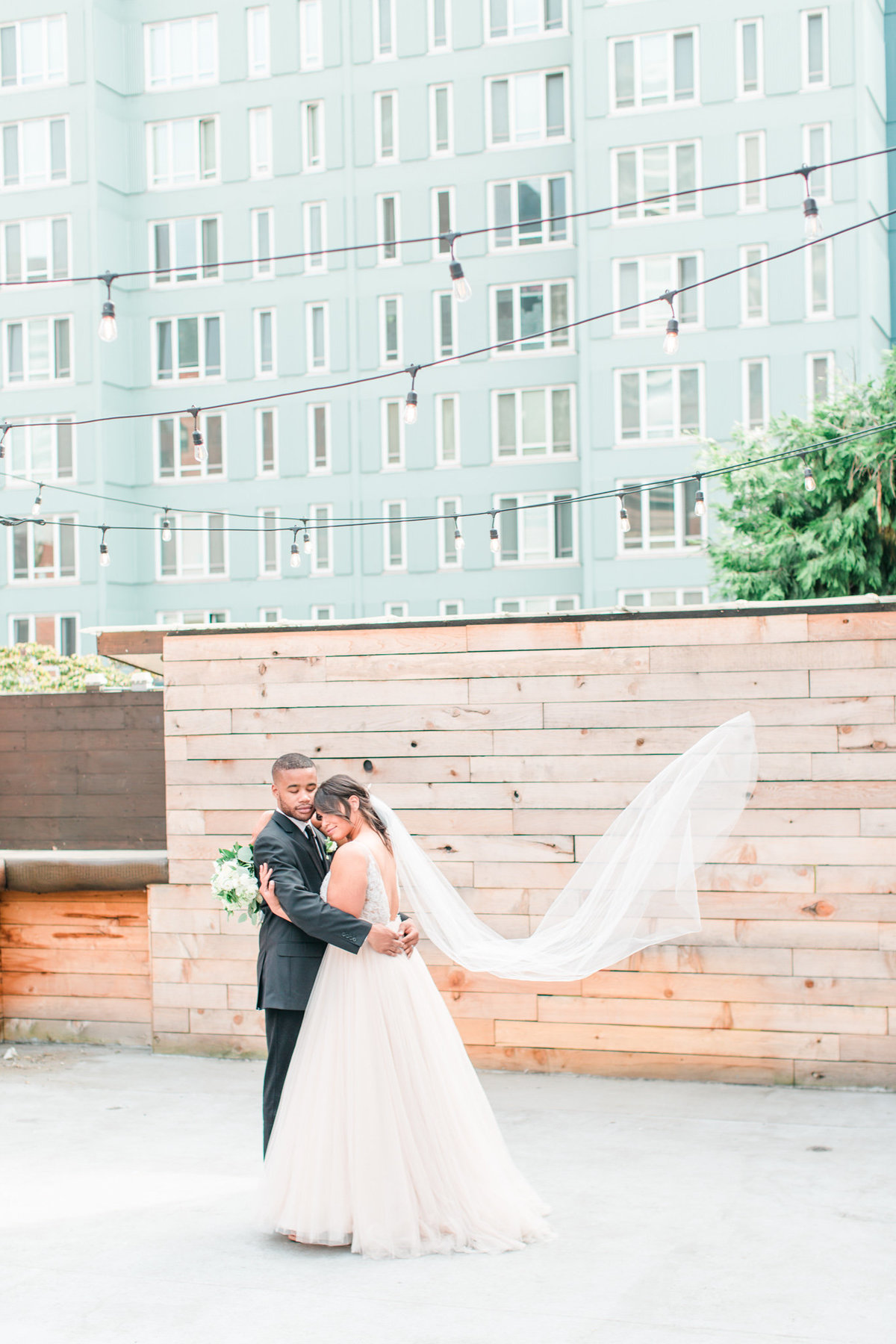 groom-bride-veil-seattle-rooftop-wedding-venue-tia-larue-photography