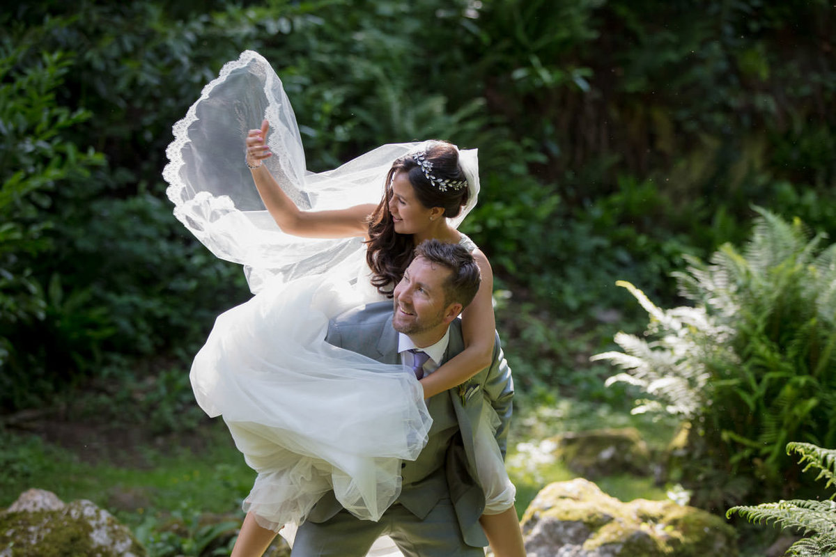 Bride on Grooms back at Hestercombe Gardens Wedding Somerset