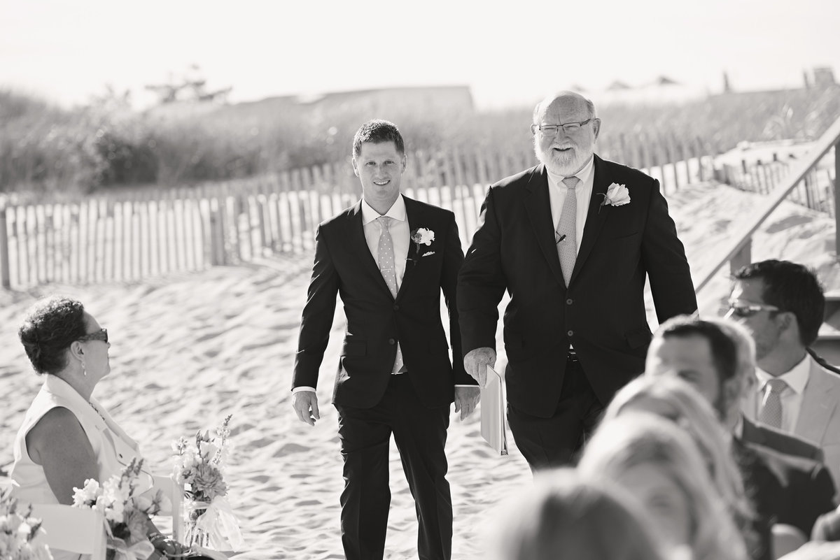 Groom walking down the aisle at Oceanbleu