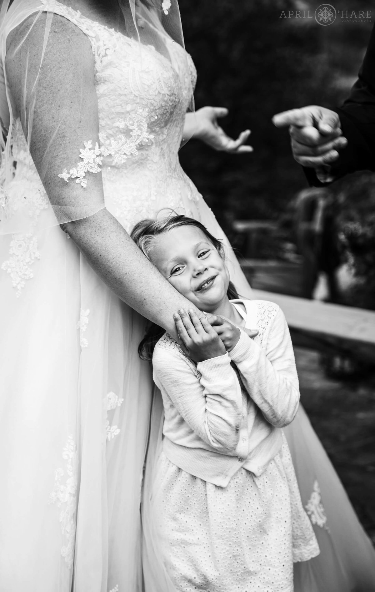 Cute B&W Photo of Flower Girl snuggling Bride at a Colorado Mountain Wedding
