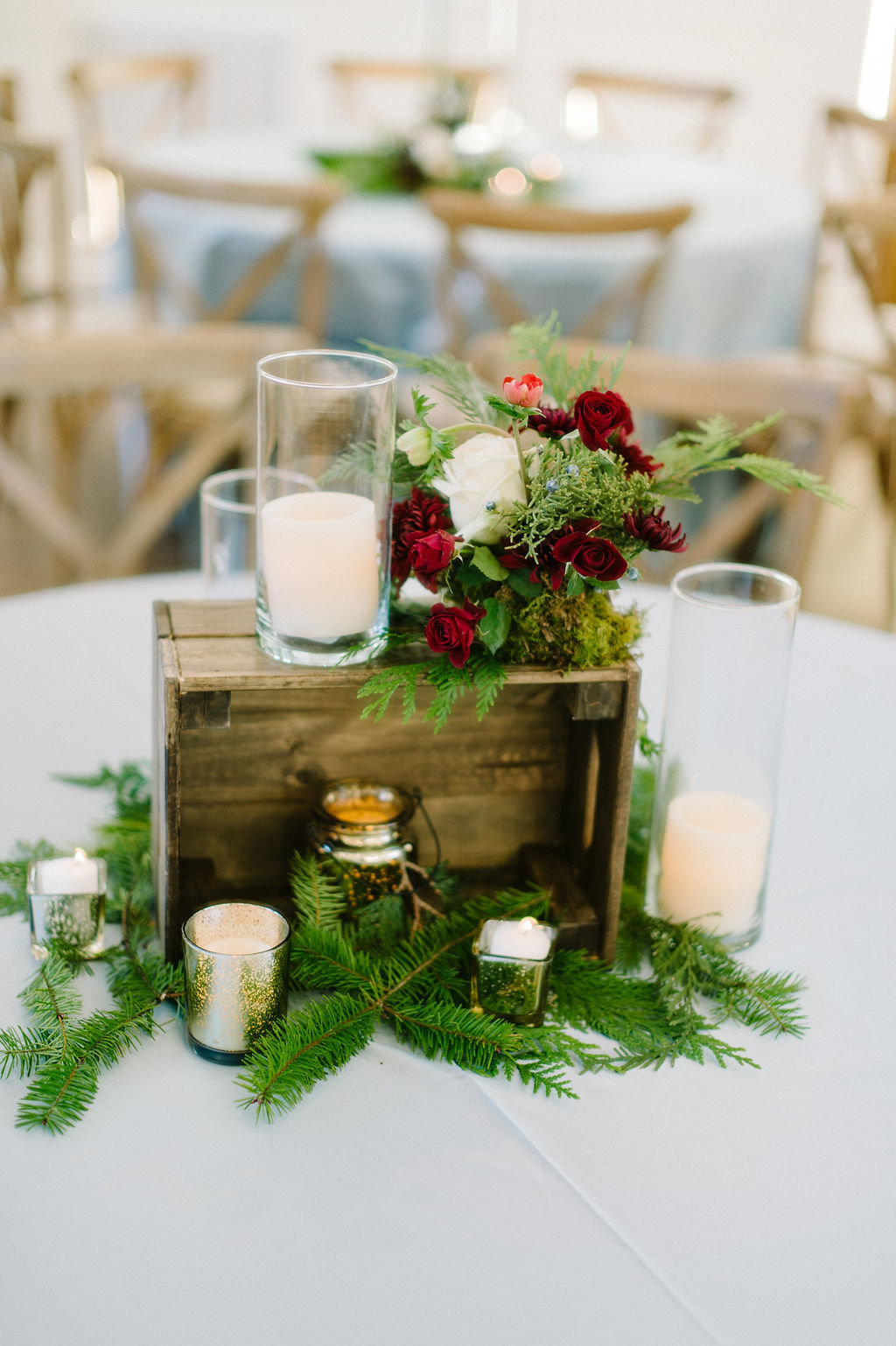 Green and red centerpieces for wedding at The Grandeur House / Tyler Rosenthal Photography