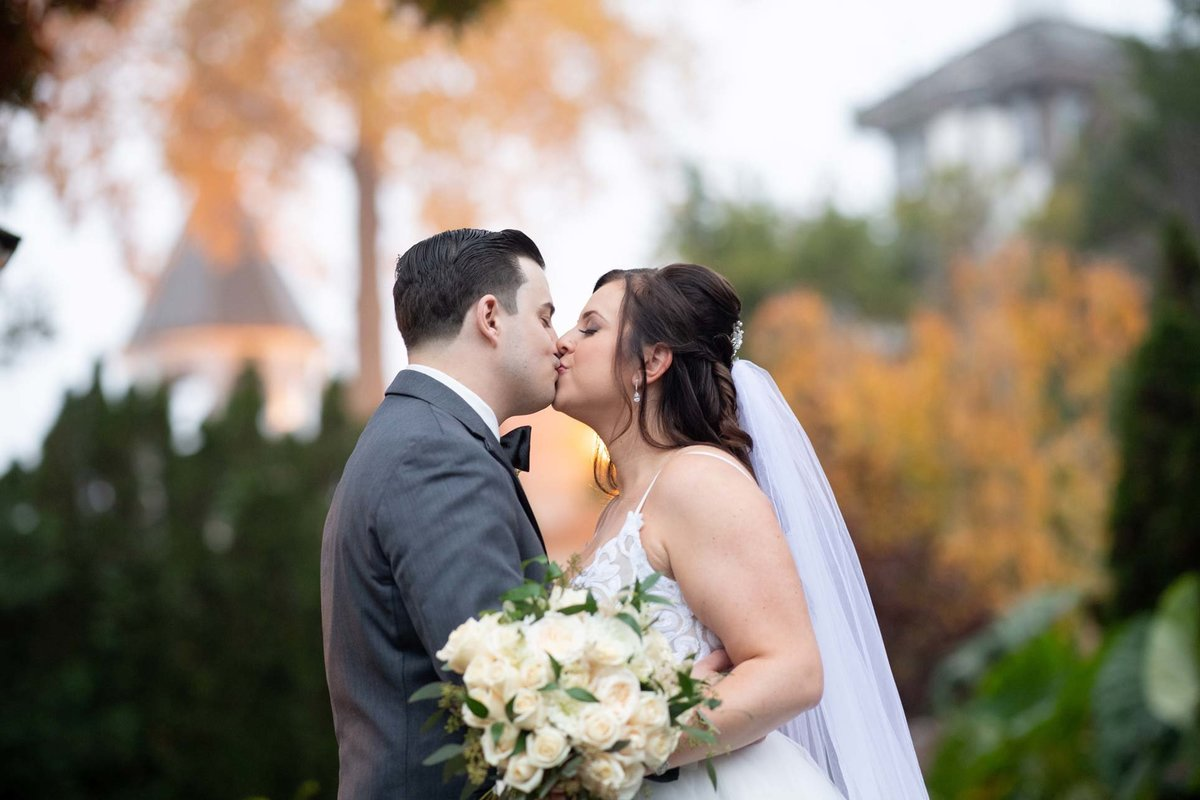 Bride and groom kissing at Fox Hollow
